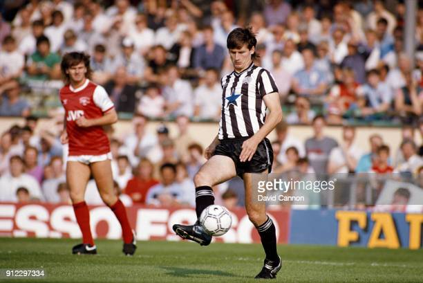 Newcastle United defender Glenn Roeder in action as Arsenal striker Charlie Nicholas looks on during a Canon League Divison One match at Highbury on...