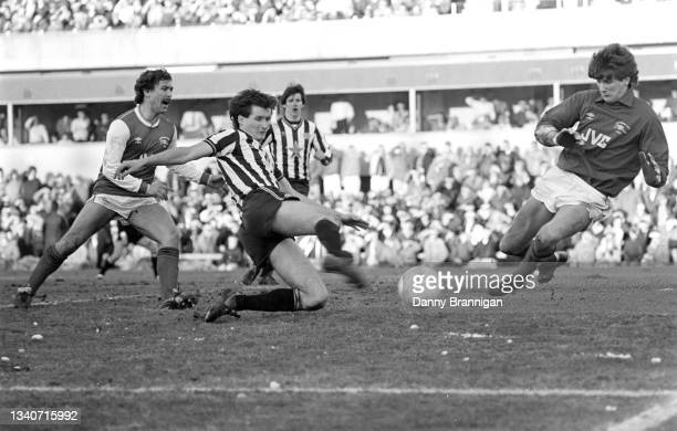 Newcastle United defender Glenn Roeder shoots to score the only goal of the game past Arsenal goalkeeper John Lukic as defender Kenny Sansom and...