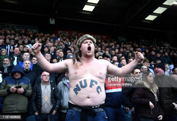 Newcastle United fan celebrates during the FA Cup Third Round match between Rochdale AFC and Newcastle United at Spotland Stadium on January 04, 2020...