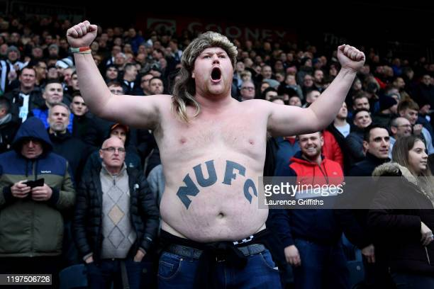 Newcastle United fan cheers on his team during the FA Cup Third Round match between Rochdale AFC and Newcastle Untied at Spotland Stadium on January...