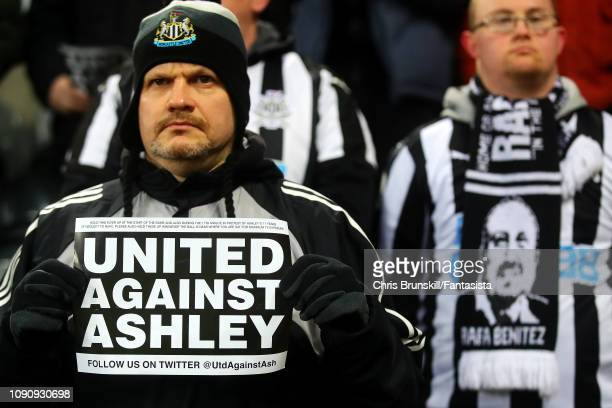 Newcastle United fan holds up a Mike Ashley banner during the Premier League match between Newcastle United and Manchester City at St. James Park on...