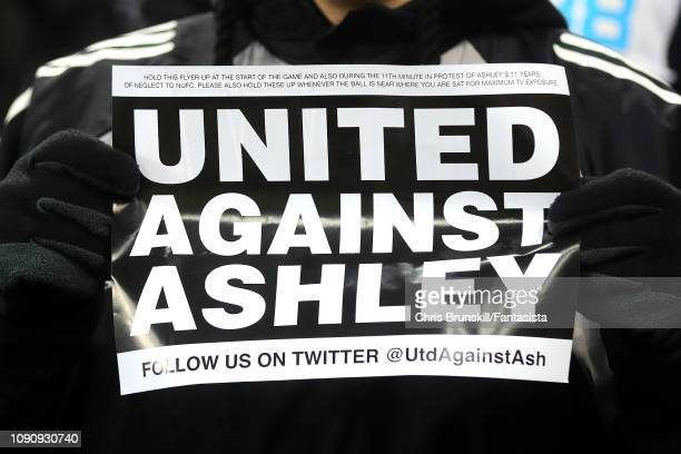 Newcastle United fan holds up a Mike Ashley banner during the Premier League match between Newcastle United and Manchester City at St James Park on...