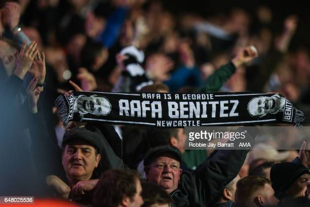 Newcastle United fan holds up a scarf that reads Rafa Is A Geordie during the Sky Bet Championship match between Huddersfield Town and Newcastle...