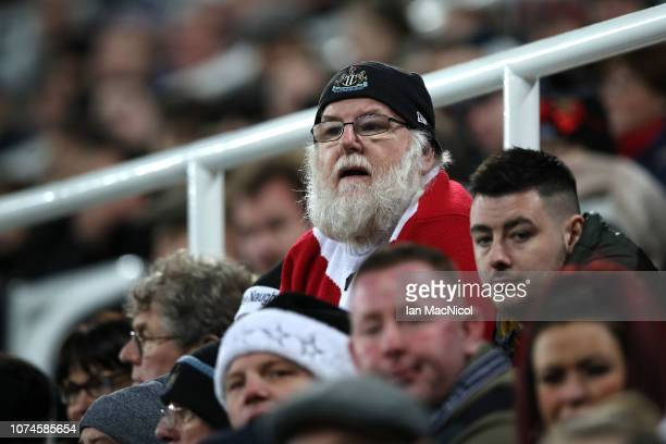 Newcastle United fan looks on during the Premier League match between Newcastle United and Fulham FC at St James Park on December 22 2018 in...