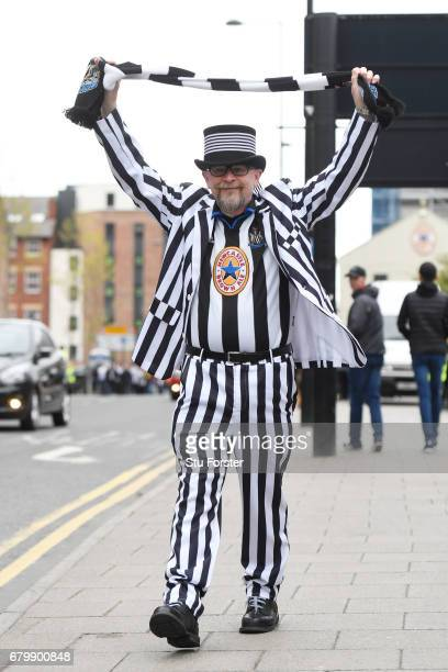 Newcastle United fan shows off his scarf prior to the Sky Bet Championship match between Newcastle United and Barnsley at St James' Park on May 7...