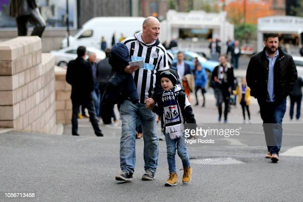 Newcastle United fans arrive outside the stadium ahead of the Premier League match between Newcastle United and Watford FC at St James Park on...