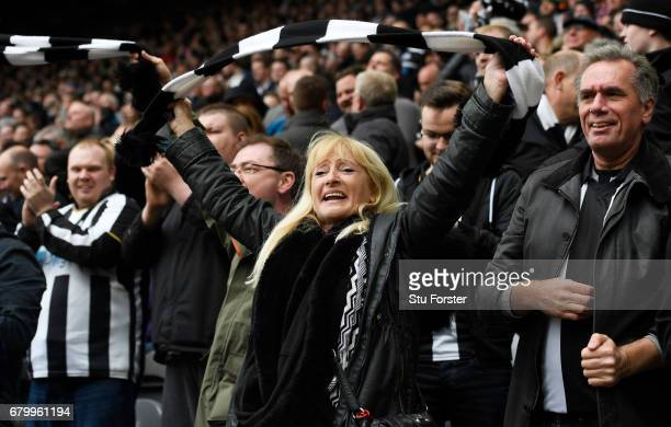 Newcastle United fans celebrate after their team winning the league title after the Sky Bet Championship match between Newcastle United and Barnsley...
