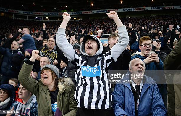 Newcastle United fans celebrate as Aleksandar Mitrovic of Newcastle United scores their second and equalising goal during the Barclays Premier League...