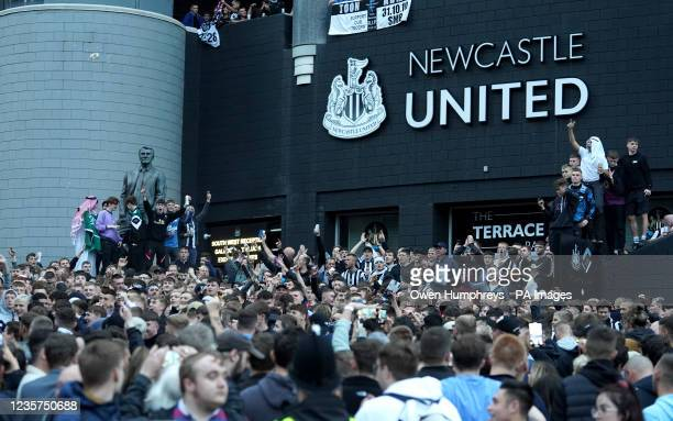 Newcastle United fans celebrate at St James' Park following the announcement that The Saudi-led takeover of Newcastle has been approved. Picture...