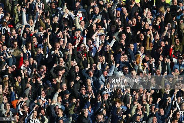 Newcastle United fans celebrate Craig Bellamy's goal during the FA Barclaycard Premiership match between Portsmouth and Newcastle United at Fratton...