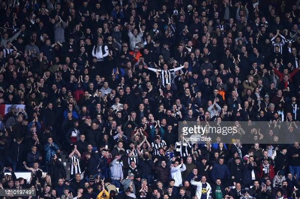 Newcastle United fans celebrate during the FA Cup Fifth Round match between West Bromwich Albion and Newcastle United at The Hawthorns on March 03...