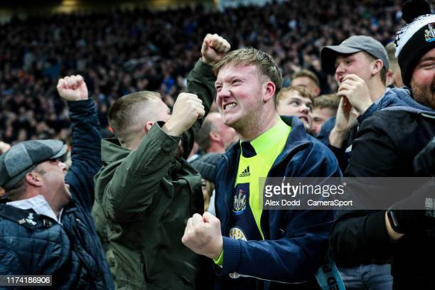 Newcastle United fans celebrate during the Premier League match between Newcastle United and Manchester United at St James Park on October 6 2019 in...