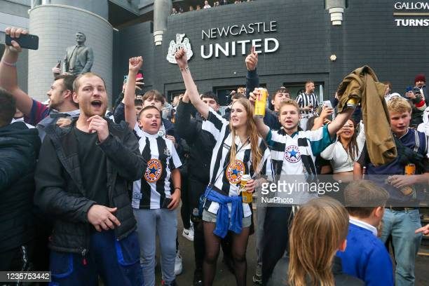 Newcastle United fans celebrate the sale of the club to the Consortium of Amanda Stavely, Jamie Rueben and PIF Scenes at St. James's Park, Newcastle...