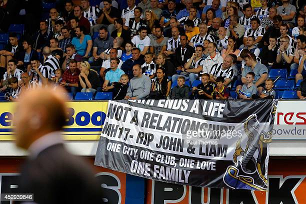 Newcastle United fans display a banner in memory of John Alder and Liam Sweeney who were involved in the Malaysian Airlines MH17 flight tragedy...