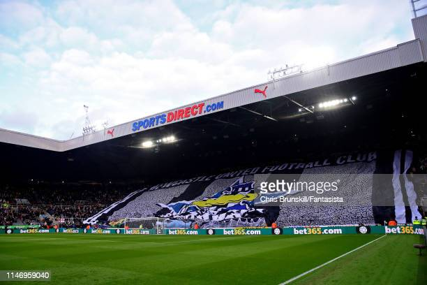 Newcastle United fans hold a banner to support their club before the Premier League match between Newcastle United and Liverpool FC at St James Park...