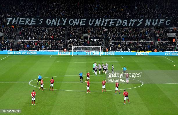 Newcastle United fans hold up a banner aimed at the Manchester United fans prior to the Premier League match between Newcastle United and Manchester...