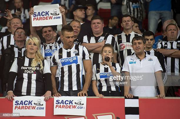Newcastle United fans hold up banners before the English Premier League football match between Stoke City and Newcastle United at the Britannia...