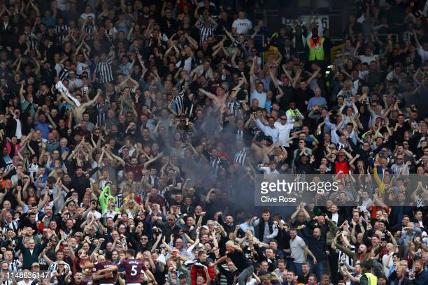 Newcastle United fans let off flares during the Premier League match between Fulham FC and Newcastle United at Craven Cottage on May 12 2019 in...