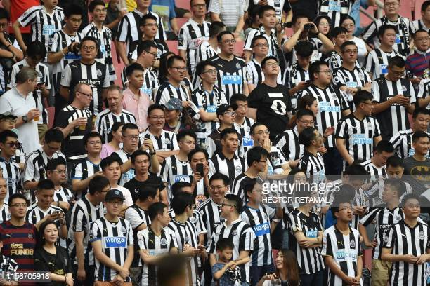 Newcastle United fans look on during their match for third place against West Ham United in the 2019 Premier League Asia Trophy football tournament...