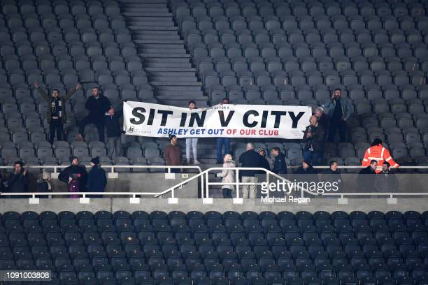 Newcastle United fans perform a sit in as a protest against Mike Ashley after the Premier League match between Newcastle United and Manchester City...
