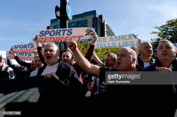 Newcastle United fans protest against chairman Mike Ashley prior to the Premier League match between Newcastle United and Leicester City at St James...