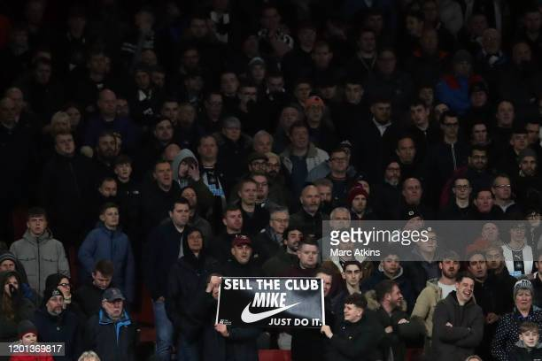 Newcastle United fans protest against owner Mike Ashley during the Premier League match between Arsenal FC and Newcastle United at Emirates Stadium...