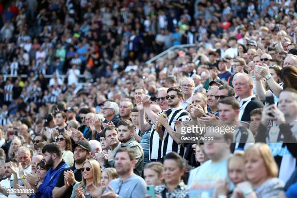 Newcastle United fans show their support prior to the Premier League match between Newcastle United and Southampton at St. James Park on August 28,...