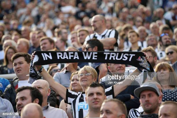 Newcastle United fans surport their team prior to the Premier League match between Newcastle United and West Ham United at St James Park on August 26...