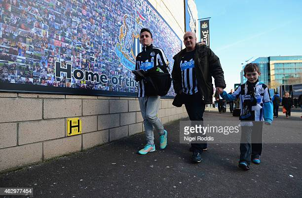 Newcastle United fans walk to the stadium prior to the Barclays Premier League match between Newcastle United and Stoke City at St James' Park on...