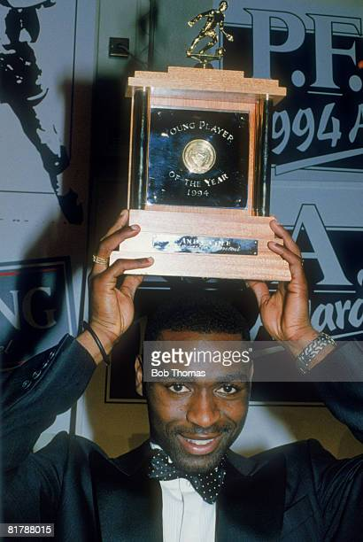 Newcastle United footballer Andy Cole receives the Young Player of the Year Award at the PFA Awards in London 10th April 1994