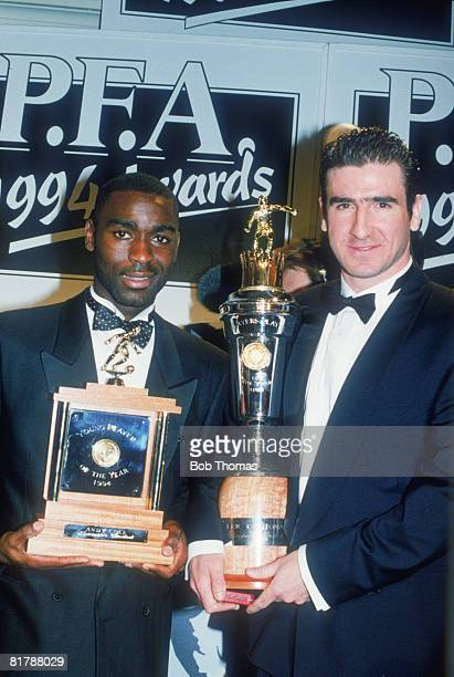 Newcastle United footballer Andy Cole receives the Young Player of the Year Award at the PFA Awards in London 10th April 1994 Beside him is Eric...