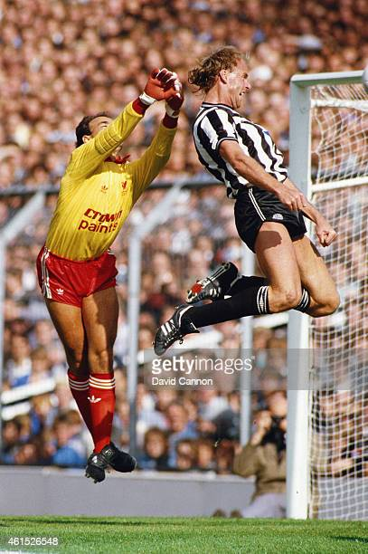 Newcastle United forward George Reilly leaps to head the ball despite the attentions of goalkeeper Bruce Grobbelaar during a Canon League Division...