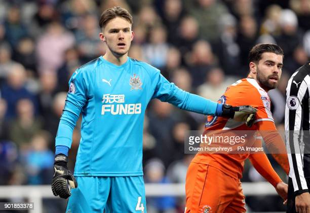 Newcastle United goalkeeper Freddie Woodman and Luton Town's Elliot Lee during the FA Cup third round match at St James' Park Newcastle