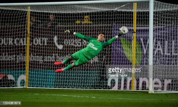Newcastle United Goalkeeper Karl Darlow dives to save the ball during the FA Cup Fourth Round Replay match between Oxford United and Newcastle United...
