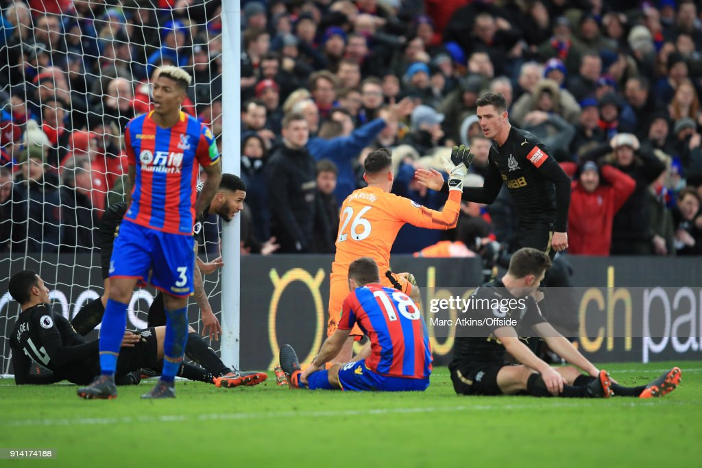 Newcastle United goalkeeper Karl Darlow thanks Ciaran Clark after he makes 2 late blocks from Christian Benteke and James McArthur during the Premier League match between Crystal Palace and Newcastle United at Selhurst Park on February 4, 2018 in London, England.