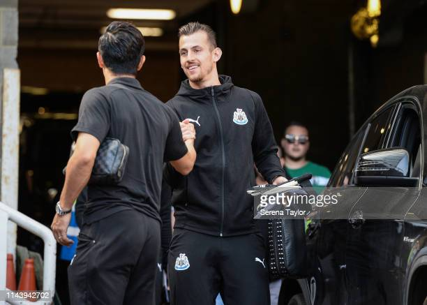 Newcastle United Goalkeeper Martin Dubravka claps hands with Yoshinori Muto as they both arrive for the Premier League match between Newcastle United...