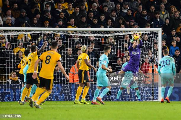 Newcastle United Goalkeeper Martin Dubravka jumps in the air to save the ball during the Premier League match between Wolverhampton Wanderers and...