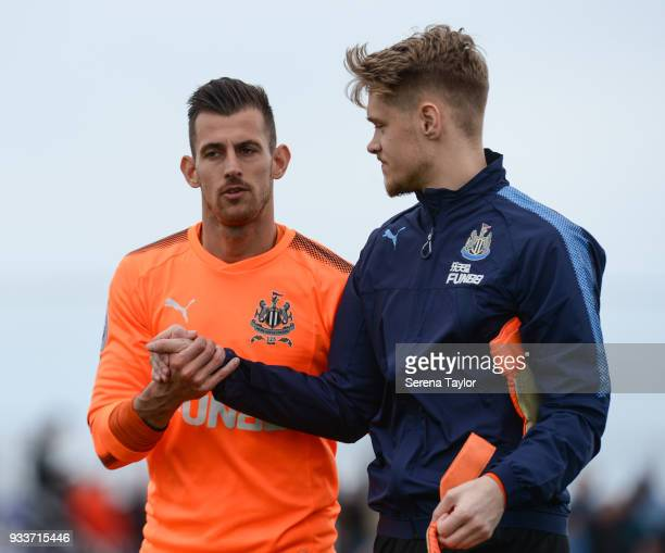 Newcastle United Goalkeeper Martin Dubravka shakes hands with young keeper Nathan Harker during the friendly match between Newcastle United and Royal...