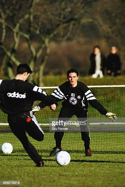 Newcastle United goalkeeper Steve Harper faces a shot from Keith Gillespie during a training session at Maiden Castle during the 1996/97 season in...