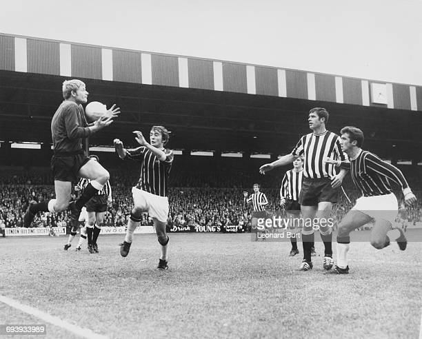 Newcastle United goalkeeper Willie McFaul jumps for the ball against Steve Kember and Cliff Jackson of Crystal Palace as Newcastle defenders Frank...