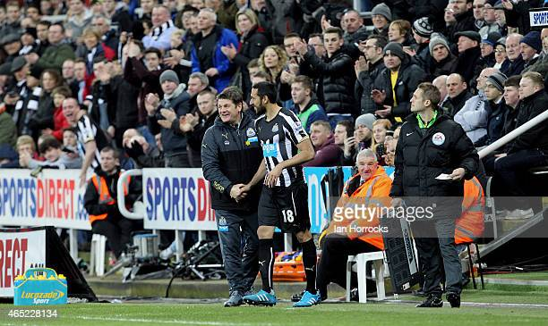 Newcastle United head coach John Carver hands Jonas Gutierrez of Newcastle United his comeback after recovering from cancer during the Barclays...