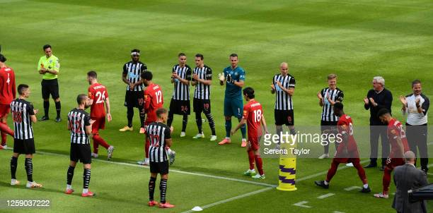 Newcastle United Head Coach Steve Bruce lines up with players in a guard of honor for the champions Liverpool during the Premier League match between...