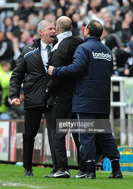Newcastle United manager Alan Pardew has to be separated from his opposite number as he argues with Sunderland manager Martin O'Neill on the touchline