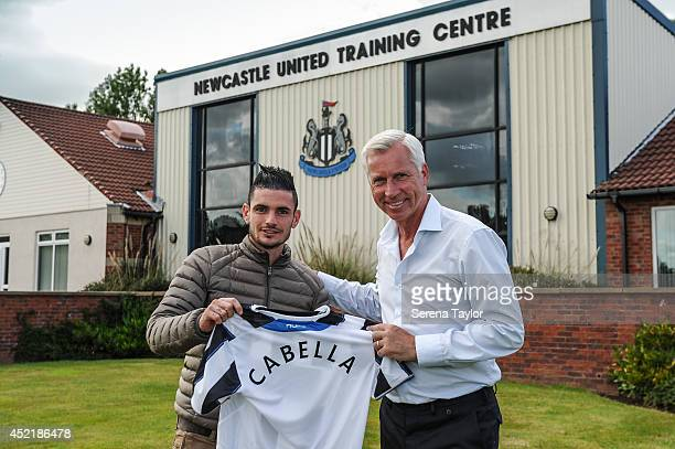 Newcastle United Manager Alan Pardew holds a Newcastle United Shirt with New signing Remy Cabella at The Newcastle United Training Centre on July 13,...