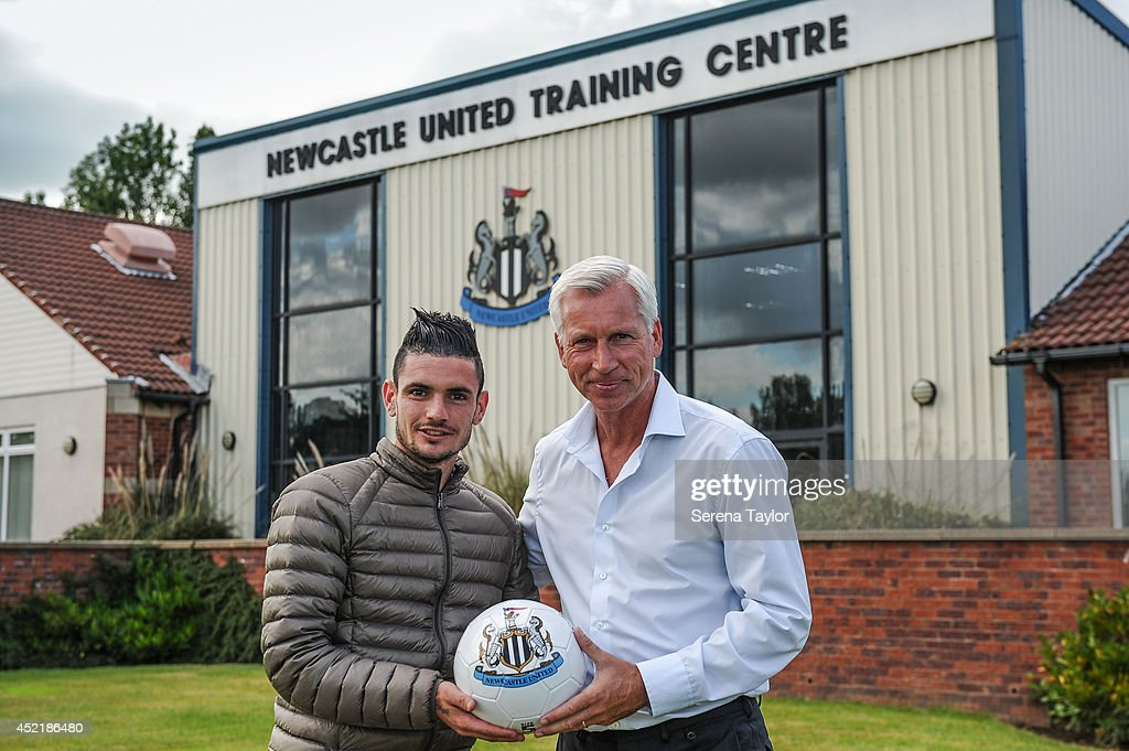 Newcastle United Manager Alan Pardew holds a Newcastle United football with New signing Remy Cabella at The Newcastle United Training Centre on July 13, 2014 in Newcastle upon Tyne, England.