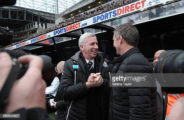 Newcastle United Manager Alan Pardew shakes hands with Cardiff City's Manager Ole Gunnar Solskjaer during the Budweiser FA Cup third round match...