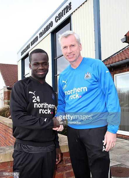 Newcastle United manager Alan Pardew shakes hands with Cheik Tiote after the midfielder agreed a new contract on February 25 2011 in Newcastle Upon...