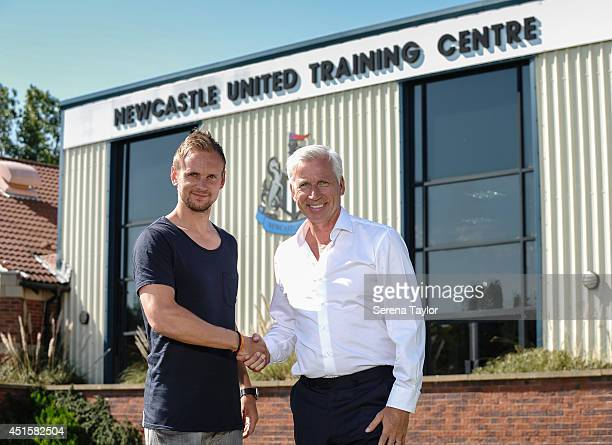 Newcastle United Manager Alan Pardew shakes hands with the New signing Siem de Jong at The Newcastle United Training Centre on July 01 2014 in...