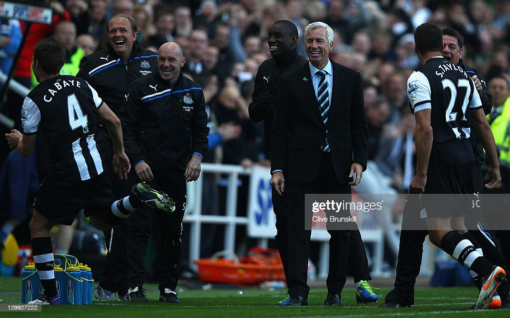 Newcastle United manager Alan Pardew shows his delight as he watches goal scorer Yohan Cabaye (4) run to the bench to celebrate during the Barclays Premier League match between Newcastle United and Wigan Athletic at St James' Park on October 22, 2011 in Newcastle upon Tyne, England.