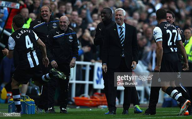 Newcastle United manager Alan Pardew shows his delight as he watches goal scorer Yohan Cabaye run to the bench to celebrate during the Barclays...